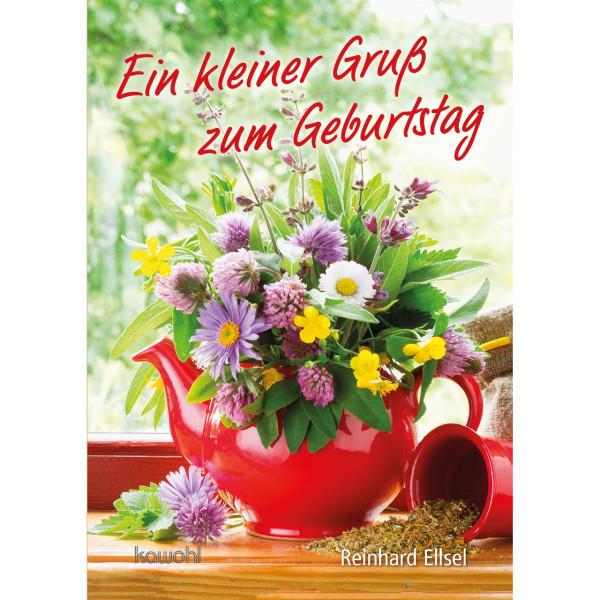 Blumenstrauß in roter Teekanne